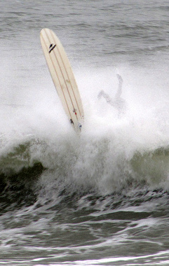 wiping out on surfboard